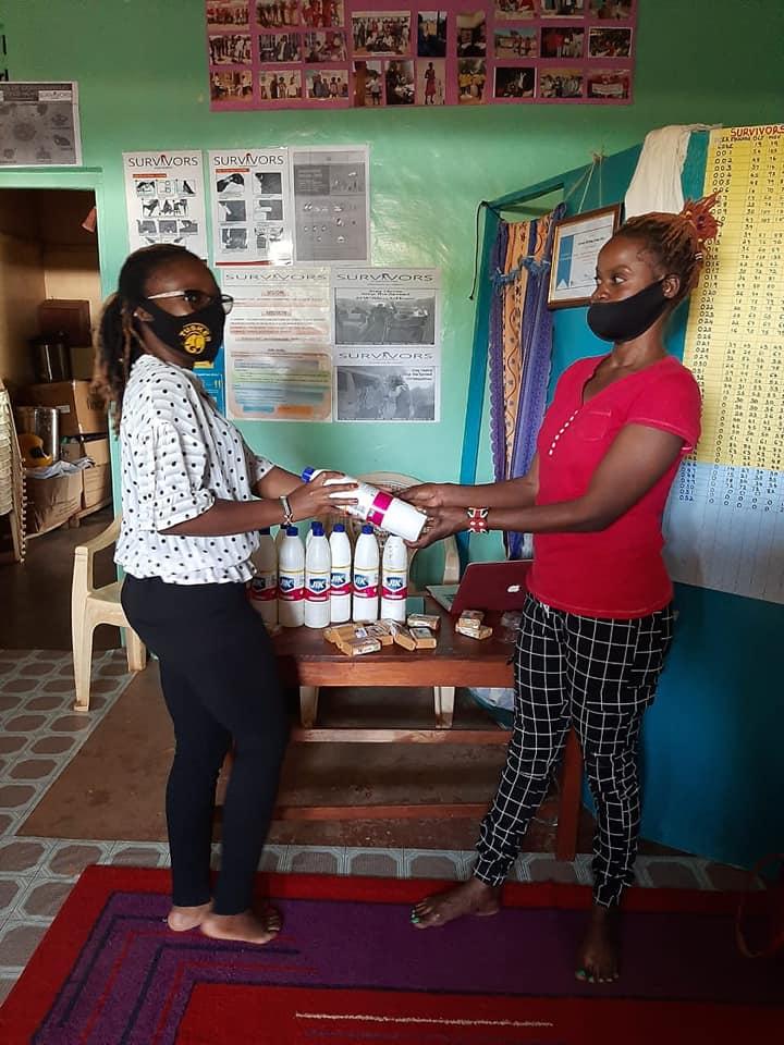 Survivors Director Madam Carole Kemunto(on the left)Distributing Hand Sanitizers to Staffs and Members